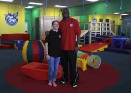 karl and shannon phillips pose for a photo at their my gym location off