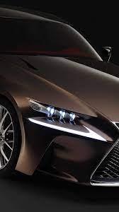 Brown Lexus RX on the black background ...