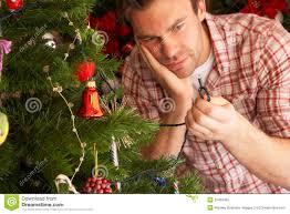 How To Check Christmas Tree Light Bulbs Young Man Trying To Fix Christmas Tree Lights Stock Image