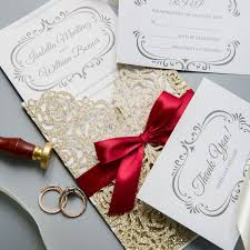 classic gold shimmer glittery laser cut wedding invitations with red ribbon bow ws018