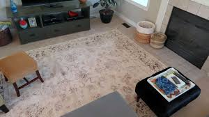 rug on carpet living room. Rug On Top Of Carpet For Living Room Ideas Combined With Ottoman Anf Black Wooden Tv