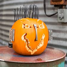 Pumpkin Carving Ideas. Pumpkin decorated with electrical wire, pull handle,  door hinges and lock.