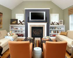 family room furniture layout. inspiration for a timeless medium tone wood floor family room remodel in boston with green walls furniture layout houzz