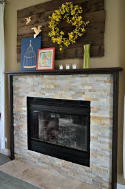 and living room decoration using round yellow wreath over fireplace including wrap around fireplace mantel and white stone tile fireplace surround