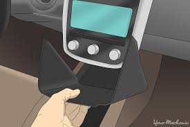 how to replace a door lock relay yourmechanic advice hand removing the panel beneath the stereo