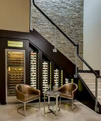 View in gallery Custom-built cooler with LED lighting for the wine cellar  under stairs [Design: