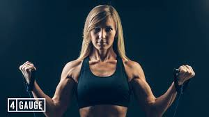 blonde haired female athlete performing a double bicep cable curl