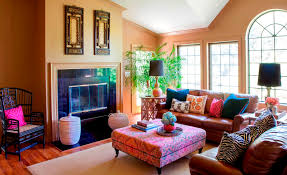 Colorful Pillows On Brown Sofas Inside Bohemian Apartment Decorating Ideas  With Modern Fireplace Facing Wide Ottoman ...