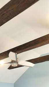 hanging a ceiling fan from suspended beam was easy due to the s hollow center