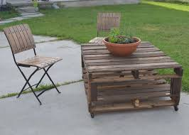 diy outdoor wood coffee table using reclaimed wood and wheels with storage for backyard garden house design with folding chairs with black metal frame