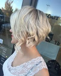 romantic blonde waves on short stacked haircuts for fine hair with disconnected layers curly stacked haircut