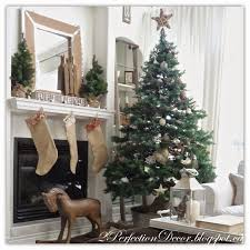 Our understated tree features a wooden star vine garland, with a mix of new  and homemade ornaments mostly made from natural materials like Burlap, ...