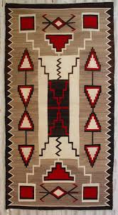an example of a navajo rug with many triangles and stepped lines