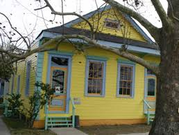 New Orleans. This Beautifully Restored Little Cottage Is Right On The Levee  In The Holy Cross Area Of The Lower 9th Ward. The Exterior Colors Include: