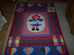 Raggedy Ann Quilt - QUILTING & The Raggedy Ann in the middle is a doll I simply cut in half. I made up the  pattern. I hope you like it. Thanks for looking. Sorry the photos are so  dark. Adamdwight.com