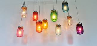 this genius diy mason jar chandelier shines a rainbow in your tiny apartment