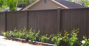 6 foot high dark stained redwood fence