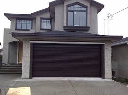 dark brown garage doorsDark brown painted residential roll up garage doors  Home Interiors