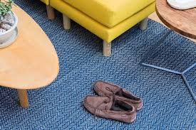 the dash albert herringbone woven cotton rug blue and white under a yellow