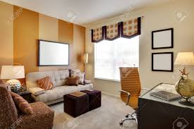 office space in living room. Small Office Space Room With Orange Accent Walls And Desk Stock Photo - 5313608 In Living
