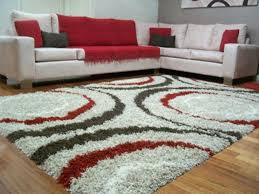 living room engaging red and gray area rugs tan black white grey abstract warmth with image