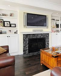 astounding home interior with fireplace mantel shelves under wide screen tv between the white books shelf photos gallery