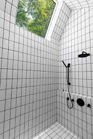 bathroom tiles black and white.  Black The White Tiles Used On The Floor And Walls Of This Bathroom Have All Been  Surrounded With Black Grout To Match Hardware Giving A  In Bathroom Tiles Black And White E