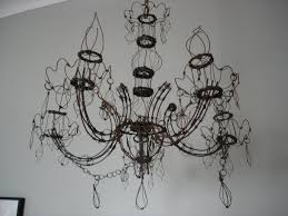 it s hard to take a picture that does it justice but it s a chandelier made of wire the wire isn t galvanized a coating that protects against oxidation