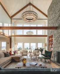 high ceiling stone fireplace great room with chandelier and wooden intended for design 16
