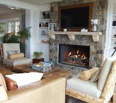 stone veneer fireplace living room beach with armchairs built in shelves built in tv coffee table