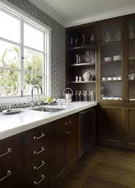 amazing kitchen design with chocolate stained kitchen cabinets marble counter top blue brown ann sacks moroccan tiles and polished nickel gooseneck