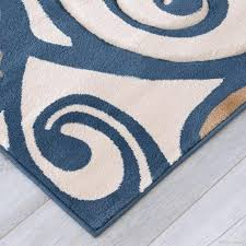 blue and brown area rugs evolution swirl rug with leaves