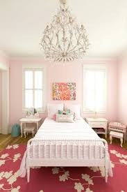 chandeliers little girl room lighting girls room painted in sherwin williams elephant pink paint with