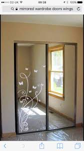 Idea: Updating Mirrored Closet Doors with Decals - Trading Phrases