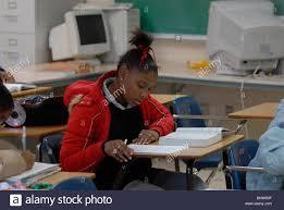 african american boy in th grade english class works on writing african american boy in 9th grade english class works on writing skills while developing a personal essay at dunbar high school