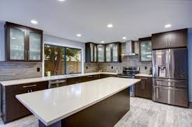 updated contemporary kitchen room interior in white and dark tones