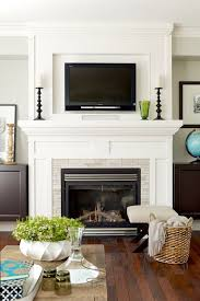 tv above fireplace really like the moulding around and above