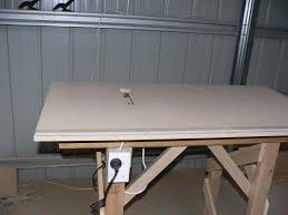 circular saw table mount. the circular saw is reverse mounted at bottom of table top. a slot cut out for blade to stick out. when not in use can be mount