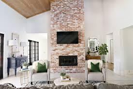 modern living room with brick fireplace. Modern Ranch Reno: How To Re-Grout A Brick Fireplace Living Room With O