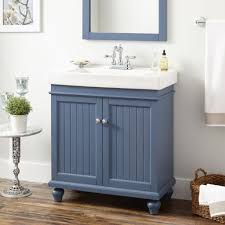 grayish blue vanity cabinet with wooden laminate floor for cool bathroom plan