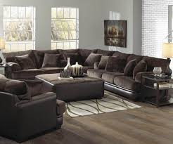 contemporary living room area with two tone brown leather velvet sectional living room sets brown