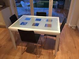 glass top dining table with wooden frame chairs