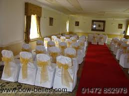 white chair cover with gold organza sash