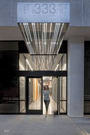 patrick tighe jazzes up two generic office buildings with sleek lobbies adelphi capital office design office refurbishment london
