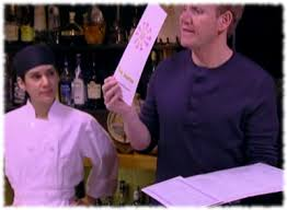 gordon ramsay holding up the new menu for fiesta sunrise on kitchen nightmares