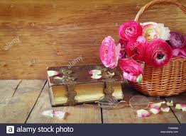 old book and gles next to beautiful field flowers on wooden table vine filtered
