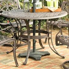 metal outdoor dining table outdoor dining table with umbrella inch round outdoor patio table in rust