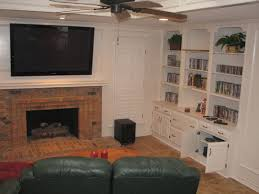 samsung tv mounted over brick fireplace equipment in cabinets to right duncanville tx built cabinet installations