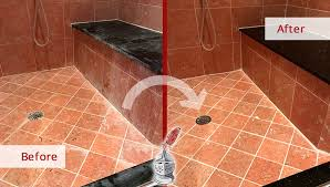 before and after picture of a marble shower grout cleaning service in belle meade tennessee