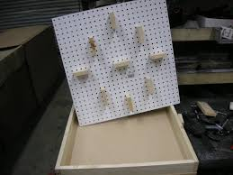 as part of the learning process i first made a simple thermal vacuum forming machine that i saw on line